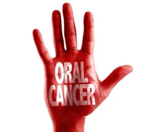 Hand with Oral cancer written on it